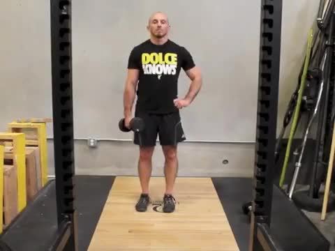 Rotational Dumbbell Straight-Leg Deadlift demonstration