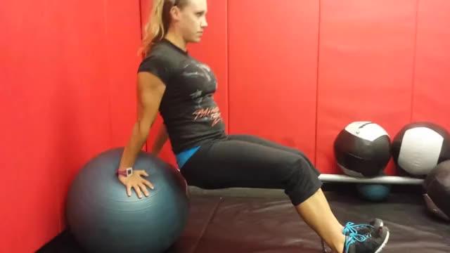 Female Exercise Ball Dip demonstration