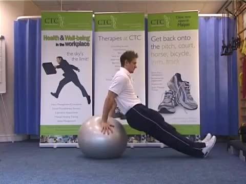 Male Exercise Ball Dip demonstration