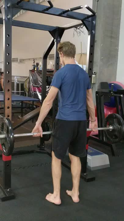 Wide-Grip Barbell Shrug demonstration
