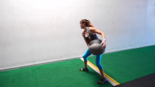 Female Medicine Ball Side Twist Throw (against wall) demonstration