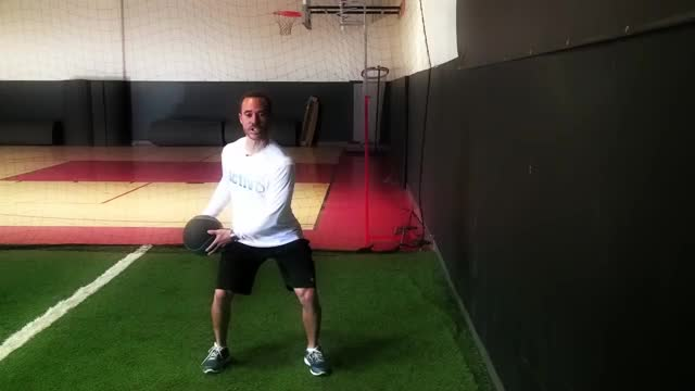 Male Medicine Ball Side Twist Throw (against wall) demonstration