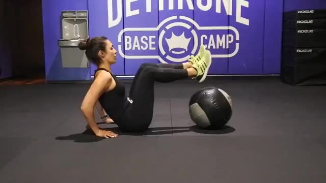 Female Medicine Ball Leg Raise demonstration