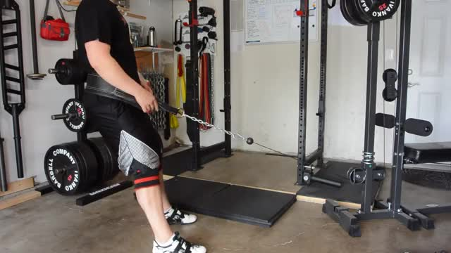 Male Cable Belt Squat demonstration