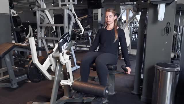 Female Lever Leg Extension (plate loaded) demonstration